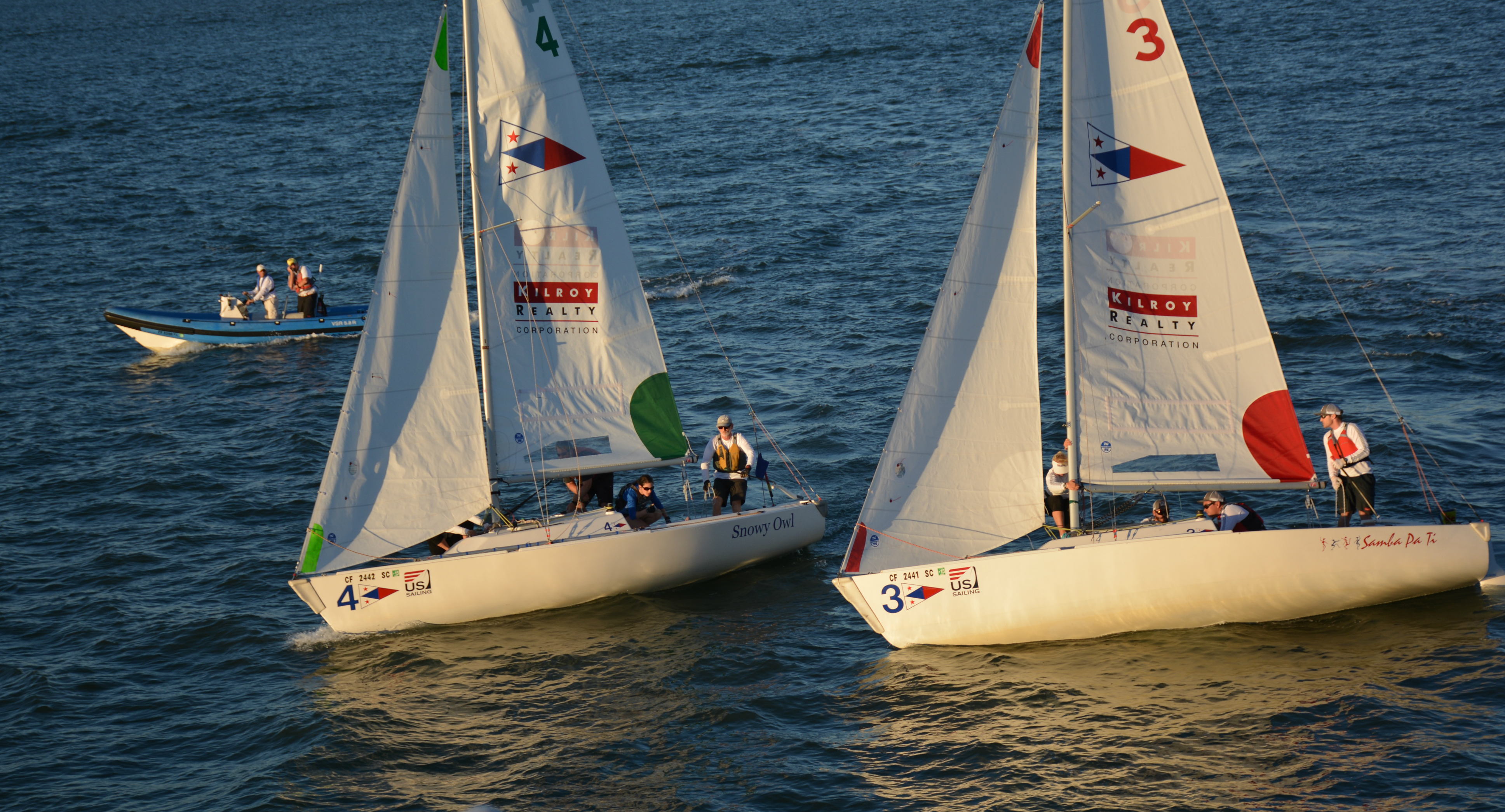 Dellenbaugh slips inside Hollerbach's line  on an upwind leg of the round robins